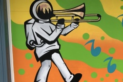 Jazz-onaut Mural, Fountain Square. This mural is located on a garage of a house on Hosbrook in Fountain Square. It's visible from the alley behind Peppys Grill on Virginia Avenue. September, 2019